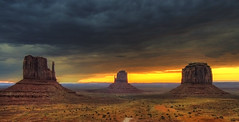 Monument Valley (Wolfgang Staudt) Tags: road morning travel red arizona sky usa sun mountains southwest nature colors beautiful yellow clouds america sunrise wonder landscape early utah amazing hit nikon bravo holidays butte view shot desert nikond70 tripod sigma roadtrip 2006 wilderness navajo monumentvalley vacancy sonnenaufgang hdr tafelberg peopleschoice coloradoplateau stativ navajonation photomatix travelphotographie thegalaxy abigfave wolfgangstaudt 66111 favemegroup3 colourartaward artofimages vigilantphotographersunite vpu2 vpu3