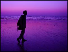 Mumbai Beach Walker (AdreWine) Tags: sunset sea india color beach silhouette twilight sand bombay bom mumbai goregoanbeach waarrebeach