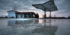 Ice Station Zero 2.8.2007 (Notley) Tags: winter sunset reflection abandoned ice evening cloudy gray gasstation missouri freeze callawaycounty reflexion reflexin 2007 feburary gasolinera froze 10thavenue odraz kingdomcity distributoredibenzina postodegasolina notley outstandingshots ruralphotography eftertanke notleyhawkins missouriphotography stationdegaz httpwwwnotleyhawkinscom notleyhawkinsphotography
