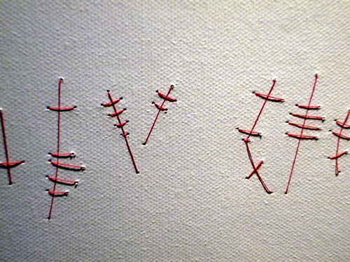 Kirsty Hall - photograph of a red thread drawing entitled Parse
