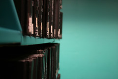 black and blue (emdot) Tags: blue black aqua books stacks serials librariesandlibrarians ll100
