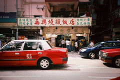 Always Long Long Queue (* andrew) Tags: road street red film car hongkong restaurant lomo lca superia taxi queue fujifilm 100 fujicolor 32mm waichai