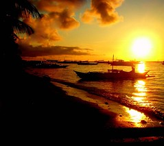 shore (totomai) Tags: ocean sea sun beach silhouette yellow boats island gold fisherman philippines earlymorning shore bohol blogged seashore flickrsbest cy2 challengeyouwinner impressedbeauty superbmasterpiece