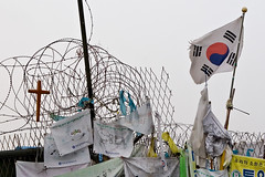 Signs of hope (kevinlamphoto) Tags: travel cold river wire war asia cross flag politics religion border photojournalism nuclear korea holy kimjongil korean christianity southkorea barbed dmz zone global northkorea reunification demilitarizedzone 38thparallel imjin