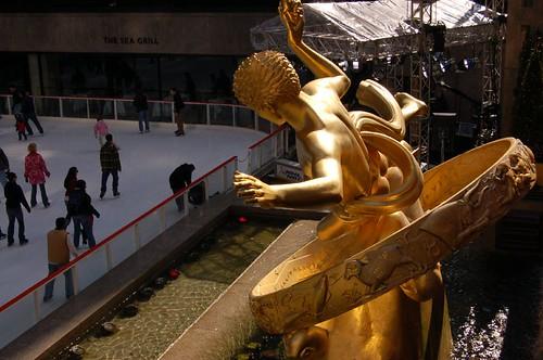 Golden Boy threatens the skaters below
