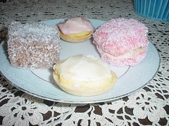 Lamington, two little iced cakes, a coconut-covered jelly cake