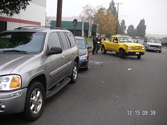 The yellow Ford hit the blue Camry into Tim's Envoy. (12/15/06)