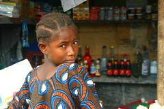 Portrait of a shopseller (LindsayStark) Tags: africa travel portrait people girl children war sierraleone conflict humanrights humanitarian displaced idpcamp refugeecamp idps idp humanitarianaid emergencyrelief idpcamps waraffected