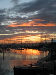 Lymington harbour at dawn (ned the head) Tags: 2005 winter sea orange reflection water sunrise dawn boat december sailing harbour hampshire isleofwight solent viewfrommywindow lymington lym
