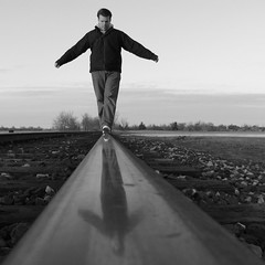 Balance (Jeremy Stockwell) Tags: railroad blackandwhite bw selfportrait reflection me lines one 1 vanishingpoint still quiet peace silent peaceful rail calm silence photofriday balance groundlevel hush stillness lowperspective canonpowershots1is jeremystockwell selfportraitchallenge jeremystockwellpix photofridayselfportrait