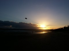 Flying kite into the sunset