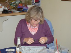 My mom, Lee, making earrings for her friend