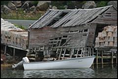 Shambles (TravisParsons) Tags: world ocean new canada digital speed canon newfoundland island photography rebel xt boat stage atlantic travis shack parsons vinland canonef100300mmf4556usm