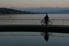 the lone biker (beegee74) Tags: sunset lake schweiz switzerland see zurich zrich tiefenbrunnen zrisee anotherbeautifulsunday perfectforabikeride