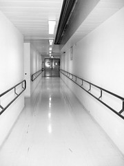 Hospital corridor, in gray (Julie70) Tags: france photoshop hospital experiments corridor mostinteresting myfavorites 2007 argenteuil mostfav someofmyfavorites copyrightjkertesz mesfavoris photojuliekertesz mypreferred julieargenteuil 100mostinteresting 120of50000