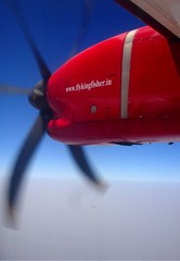 In Flight, VT-KAD ATR72-200 (Aiel) Tags: red motion blur airplane inflight aircraft bluesky kingfisher propeller windowseat atr atr72 atr72212 vtkad