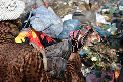 Shoes (justrollthedice) Tags: poverty brown trash work john shoe workers garbage shoes asia cambodia bottles recycled pair south poor working dump east plastic waste southeast refuse recycle ngo landfill penh johnbrown recycleable camstungmeancheyphnompenhphnom