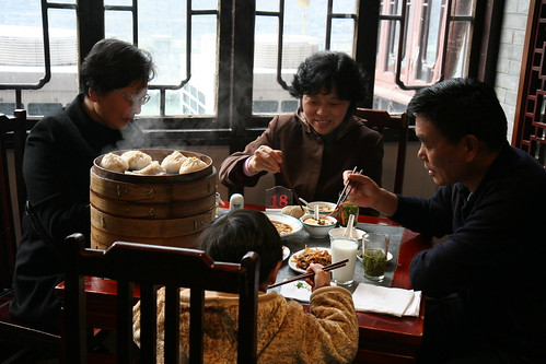 Family enjoying tea and dimsum