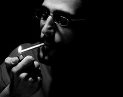 Satisfaction (Eugenia Moira Angela Darling) Tags: boy portrait people blackandwhite bw glasses cigarette smoking flame marco lighter ritratto barba biancoenero fiamma occhiali sigaretta accendino odoacre