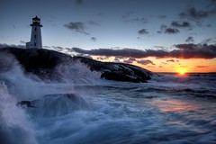 Peggy's Cove Lighthouse II (iJohn) Tags: ocean sunset sea lighthouse tag3 taggedout clouds coast bravo surf tag2 waves tag1 novascotia village peggyscove outport 80points abigfave impressedbeauty elegantgroup