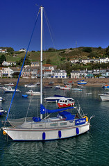 Gorey Harbour - Jersey (jerseyimage) Tags: greatbritain november houses sea portrait reflection slr beach canon boats outside islands coast boat seaside day harbour tide hill bluesky stmartin coastal jersey nautical digitalslr hdr channelislands channel gorey altair sailingboat 1746 tonemapped goreyharbour subtlehdr 400d 1855mmkit jy1326 cotil jy1746 jerseyimage