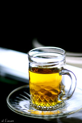 Cinnamon tea :D [ Yummi ] (Al Fassam) Tags: light shadow white black reflection cup glass yellow canon wow golden yummy amazing tea drink bokeh cinnamon clarity faves estkanah darsen