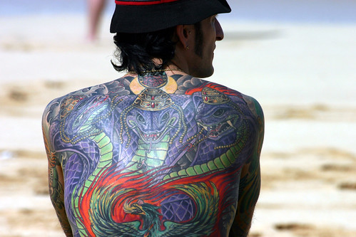 Full back piece very colorful design of serpents, snakes as the king cobra.