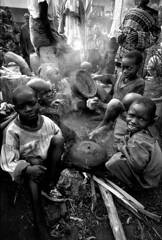 Rwandan refugees (nick rain images) Tags: poverty africa boys fire war tea refugees rwanda hunger genocide
