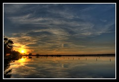 Glassy Sunset (sunsurfr) Tags: blue trees sunset sky orange sun reflection beach water colors yellow clouds mirror nikon colorful alabama feather explore d200 hdr gulfshores photomatrix nikonstunninggallery nikonstunning gulfshorestriphdrfortmorgan sunsurfr