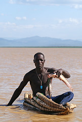 Fisherman on Lake Baringo showing his catch (imanh) Tags: africa people lake fish man boot boat fishing fisherman meer kenya visser catch afrika kenia iman baringo heijboer vangst imanh