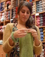 Irini and her WIP dress (sifis) Tags: art wool sweater nikon knitting action knit athens yarn greece mohair d200 cardigan handknitting yarnshop sakalak woolshop