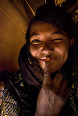 Fun in the Tent (Swiatoslaw Wojtkowiak) Tags: africa woman mountains girl smile niger desert joke air joy tribal tent nomad ethnic wink touareg indigenous tuareg tamashek