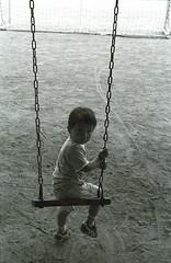 On swing. (delta16v) Tags: park boy blackandwhite bw white black monochrome kid play monotone swing