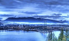 The Blue Storm (Stuck in Customs) Tags: ocean bridge blue sky mountain storm water fog vancouver clouds photography evening bay nikon scenery photographer britishcolumbia d2x hdr westvancouver highquality waterbody d2xs stuckincustoms imagekind treyratcliff stuckincustomsgooglescreensaver
