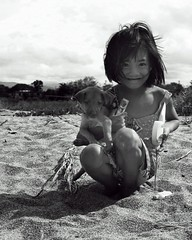 ZAMBALES: portraits7. (theshanghaieye) Tags: portrait blackandwhite bw dog playing beach clouds puppy interestingness sand sandy philippines barbie sunny monotone explore portraiture tropical tropics zambales