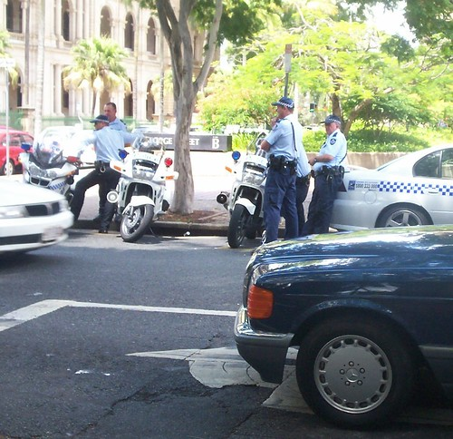 Police officers, road bikes and patrol car on George St, near cnr of Alice St - Invasion Day Rally and March 070126