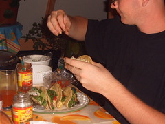 Jayme dressing his shredded beef tacos (KimmyFP) Tags: tacos mexican shreddedbeef