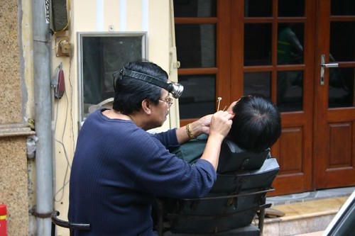 Checking ears in down town Hanoi is not a private affair!