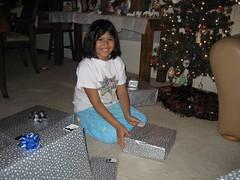Anna opens up a present. (01/07)