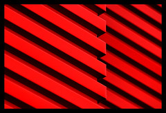 red decline (♫ marc_l'esperance) Tags: light red abstract color colour building geometric lines metal composition facade contrast canon dark eos bars geometry abstractart stripes © 2006 10d abstraction jpg minimalism siding nocrop parallel uncropped staples minimalist allrightsreserved cml intersecting canonef70200mmf28lusm canon70200f28l bronly borderingperception
