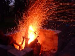 sparks (jypsygen) Tags: longexposure hot night fire twilight fireplace glow wind dusk logs burn stick stir breeze sparks firepit lightstreaks