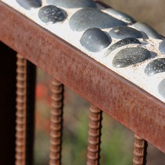 Handrail on Bridge (detail) (Daniel Greene) Tags: morning bridge macro square spring stones tripod cement rusty overexposed cropped handrail crusty desertbotanicalgarden rc1