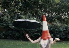 i dont know what this means (hool a hoop) Tags: selfportrait umbrella garden cone surreal trafficcone
