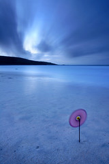 Pinwheel (Adam Clutterbuck) Tags: ocean uk longexposure greatbritain blue sea seascape 20d beach windmill night clouds landscape toy coast twilight sand cornwall wind dusk sandy windy canoneos20d coastal shore spinning gb pinwheel stives oe porthmeor westpenwith shorescape penwith greengage porthmeorbeach vle shorescapes adamclutterbuck cornishcoast streakedcloud showinrecentset openedition