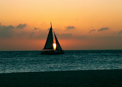 Sailboat Eclipse (Musical Mint) Tags: ocean sunset sky sun colour beach water beautiful silhouette sailboat island eclipse amazing view carribean aruba setting timing abigfave