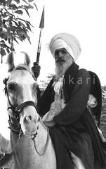 Akali Nihang Singh (Chitrakari) Tags: horse india interestingness cool explore canon350d warrior sikh punjab hindu spear singh akali nihang superaplus talwandi diamondclassphotographer