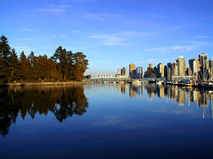 Vancouver, view from Stanley Park (kenyai) Tags: park trees lake canada reflection water vancouver cityscape skyscrapers acqua riflesso interestingness52 i500 18012007