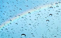 coloured rain (BlueBreeze) Tags: water rain rainbow wasser bow raindrops coloured regen regenbogen bogen regentropfen
