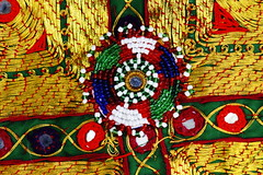 Bright, Colorful Decoration (Palmer Digital Studio) Tags: blue red afghanistan detail macro green yellow closeup canon french eos beads coins jewelry jade eggs quarter bazaar kabul lapis 30d canoneos30d
