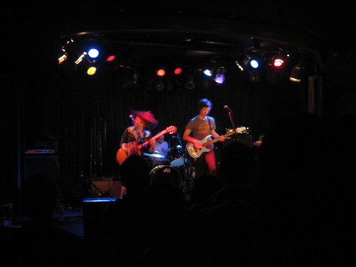 The Happy Hollows: three musicians playing on stage